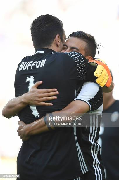 Juventus' goalkeeper from Italy Gianluigi Buffon celebrates with Juventus' forward from Argentina Paulo Dybala after winning the Italian Serie A...