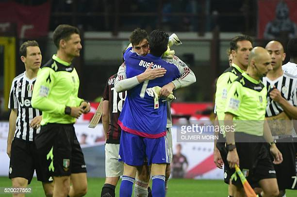 Juventus' goalkeeper from Italy Gianluigi Buffon congratulates 17 years old AC Milan's goalkeeper from Italy Gianluigi Donnarumma after the Italian...