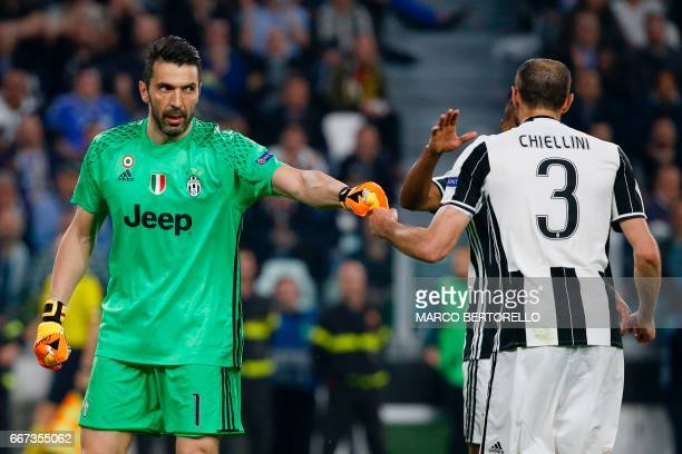 Juventus' goalkeeper from Italy Gianluigi Buffon congratulates Juventus' defender from Italy Giorgio Chiellini during the UEFA Champions League...