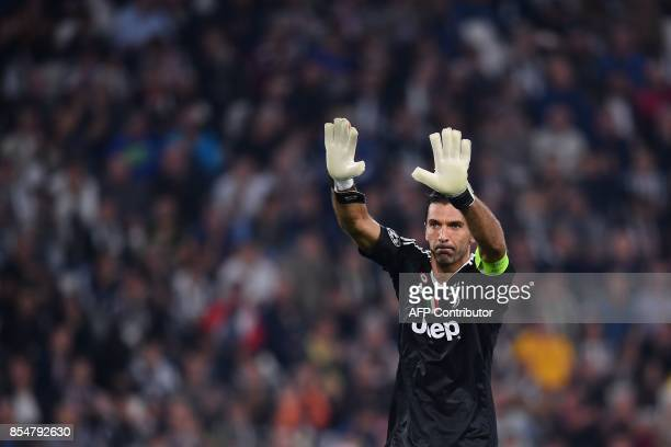 Juventus' goalkeeper from Italy Gianluigi Buffon greets fans before the UEFA Champion's League Group D football match Juventus vs Olympiacos on...
