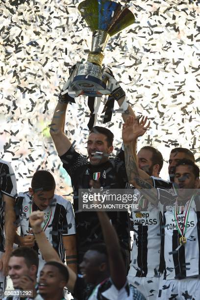 Juventus' goalkeeper from Italy Gianluigi Buffon holds the trophy after winning the Italian Serie A football match Juventus vs Crotone and the...