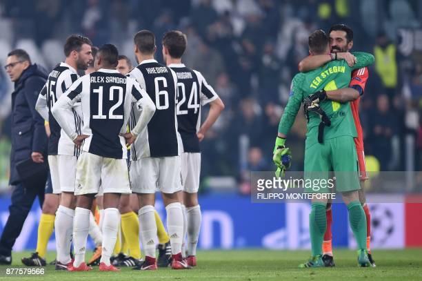 Juventus' goalkeeper from Italy Gianluigi Buffon hugs Barcelona's German goalkeeper MarcAndre Ter Stegen at the end of the UEFA Champions League...