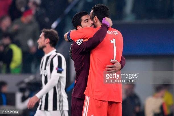 Juventus' goalkeeper from Italy Gianluigi Buffon hugs Barcelona's Uruguayan forward Luis Suarez at the end of the UEFA Champions League Group D...