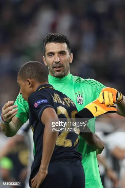 Juventus' goalkeeper from Italy Gianluigi Buffon hugs Monaco's French forward Kylian Mbappe after Juventus won the UEFA Champions League semi final...