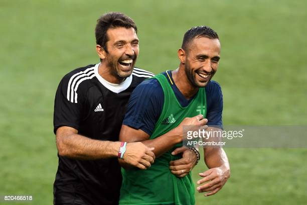 Juventus' goalkeeper from Italy Gianluigi Buffon jokes with a teammate during a training session at the Red Bull Arena in Harrison New Jersey on July...