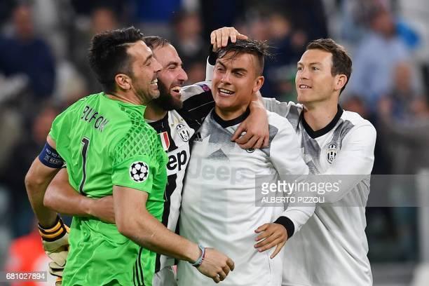 Juventus' goalkeeper from Italy Gianluigi Buffon Juventus' forward from Argentina Gonzalo Higuain and Juventus' forward from Argentina Paulo Dybala...