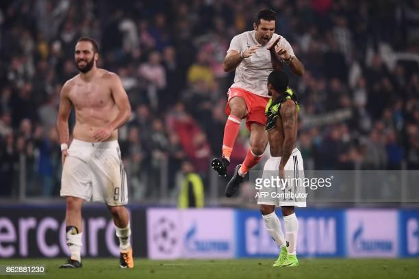 Juventus' goalkeeper from Italy Gianluigi Buffon Juventus' forward from Brazil Douglas Costa and Juventus' forward from Argentina Gonzalo Higuain...