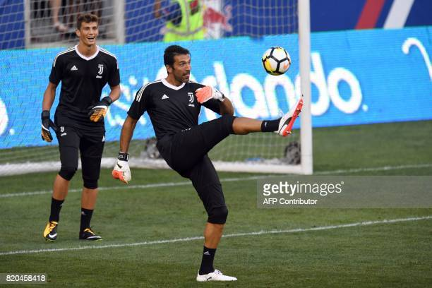 Juventus' goalkeeper from Italy Gianluigi Buffon kicks the ball during a training session at the Red Bull Arena in Harrison New Jersey on July 21 a...