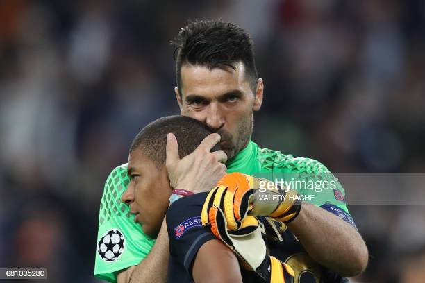 Juventus' goalkeeper from Italy Gianluigi Buffon kisses Monaco's French forward Kylian Mbappe after Juventus won the UEFA Champions League semi final...