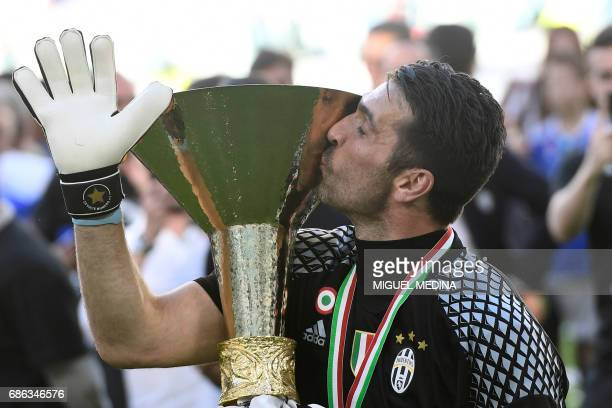 Juventus' goalkeeper from Italy Gianluigi Buffon kisses the trophy after winning the Italian Serie A football match Juventus vs Crotone and the...