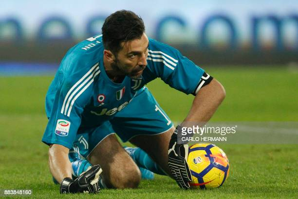 Juventus' goalkeeper from Italy Gianluigi Buffon makes a save during the Italian Serie A football match Napoli vs Juventus on December 1 2017 at the...