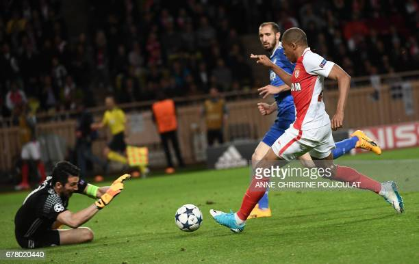 Juventus' goalkeeper from Italy Gianluigi Buffon prepares to block a shot on goal by Monaco's French forward Kylian Mbappe during the UEFA Champions...