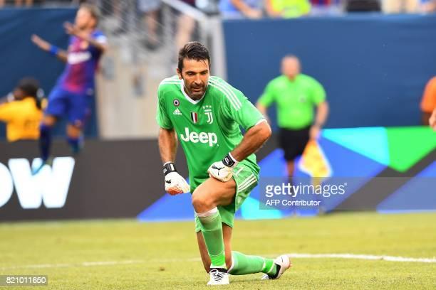 Juventus' goalkeeper from Italy Gianluigi Buffon reacts after Barcelona's Brazilian forward Neymar scored his second goal during the International...