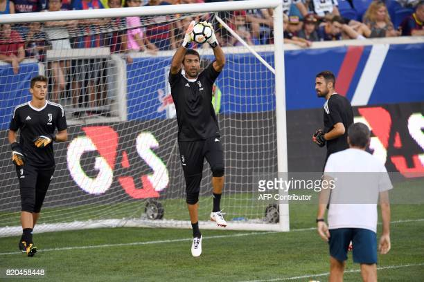 Juventus' goalkeeper from Italy Gianluigi Buffon stops the ball during a training session at the Red Bull Arena in Harrison New Jersey on July 21 a...