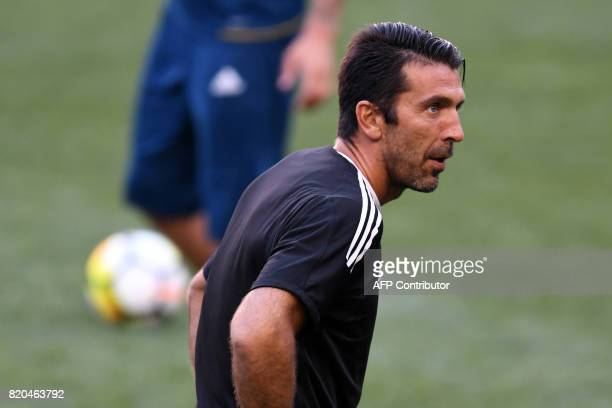 Juventus' goalkeeper from Italy Gianluigi Buffon stretches during a training session at the Red Bull Arena in Harrison New Jersey on July 21 a day...
