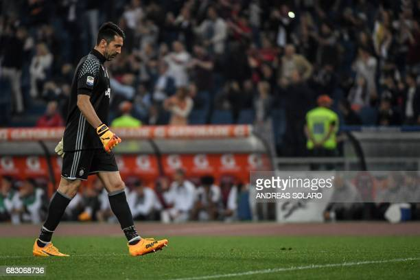 Juventus' goalkeeper from Italy Gianluigi Buffon walks on the pitch during the Italian Serie A football match Roma vs Juventus on May 14 2017 at...