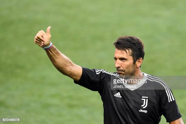 Juventus' goalkeeper from Italy Gianluigi Buffon waves at fans after a training session at the Red Bull Arena in Harrison New Jersey on July 21 a day...