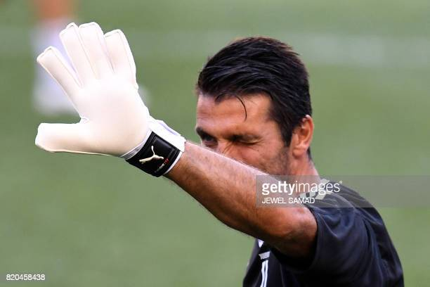 Juventus' goalkeeper from Italy Gianluigi Buffon waves at fans during a training session at the Red Bull Arena in Harrison New Jersey on July 21 a...