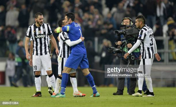 Juventus goalkeeper Gianlugi Buffon andCarlos tevez celebrate after the final whistle
