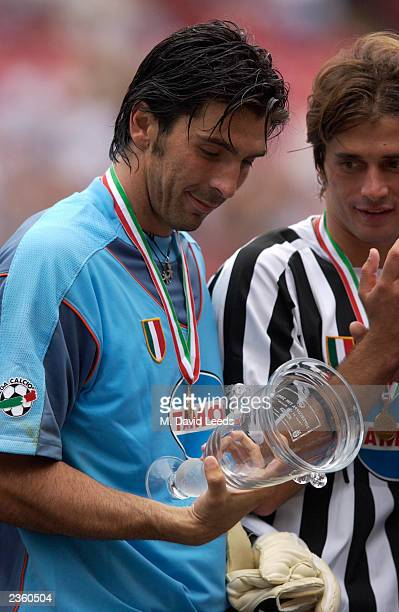 Juventus goalkeeper Gianluigi Buffon admires his man of the match cup following the Supercoppa match between Juventus and AC Milan on August 3 2003...