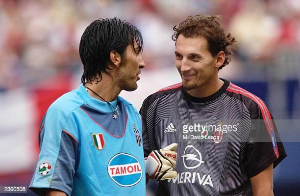 Juventus goalkeeper Gianluigi Buffon and AC Milan goalkeeper Val Fiorio exchange a few words of encouragement prior to the penalty kick shootout...