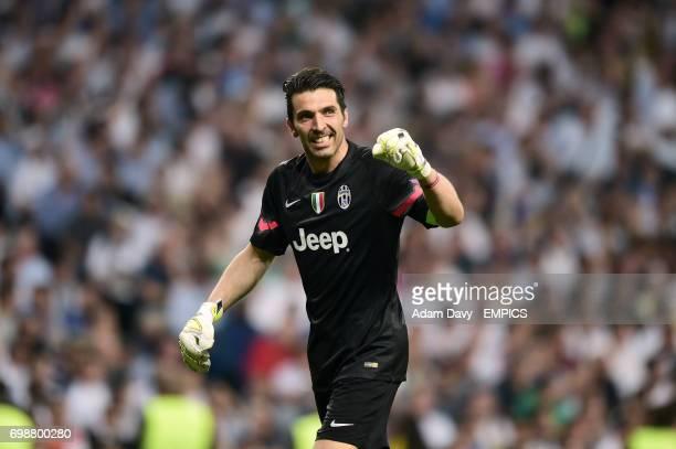 Juventus goalkeeper Gianluigi Buffon celebrates Alvaro Morata scoring their first goal of the game