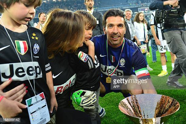 Juventus' goalkeeper Gianluigi Buffon celebrates with his family during the ceremony of the Scudetto the Italian Serie A trophy after the Italian...
