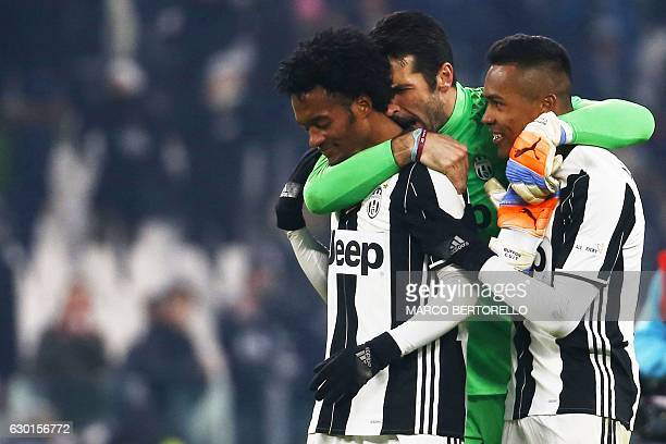 Juventus' goalkeeper Gianluigi Buffon celebrates with Juventus' midfielder Juan Cuadrado of Colombia and Juventus' defender Alex Sandro of Brazil...