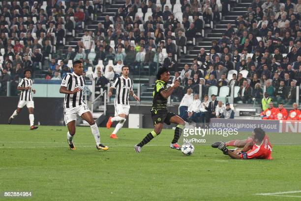 Juventus goalkeeper Gianluigi Buffon dives for the ball during the Uefa Champions League group stage football match n3 JUVENTUS SPORTING on at the...