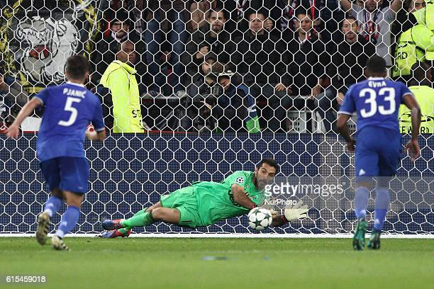 Juventus goalkeeper Gianluigi Buffon dives for the ball saving the penalty kick during the Uefa Champions League group stage football match n3 LYON...
