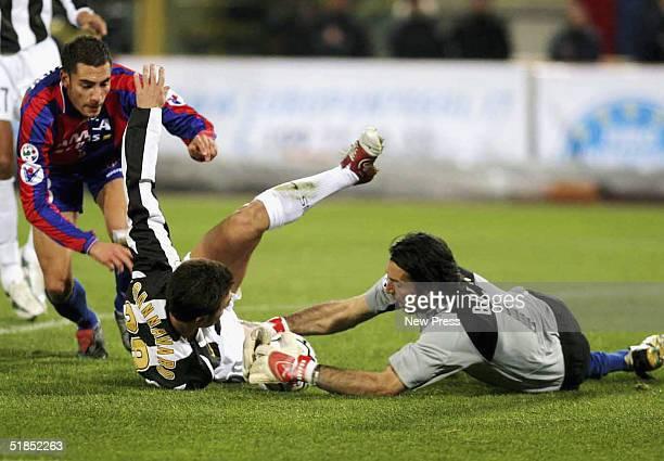 Juventus goalkeeper Gianluigi Buffon dives on the ball as Mourad Meghni of Bologna tangles with Fabio Cannavaro during the Bologna v Juventus Serie A...