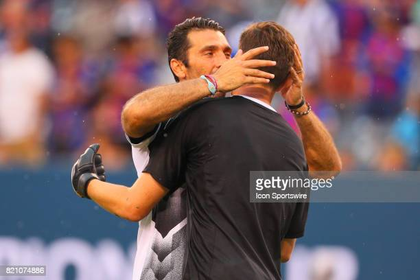 Juventus goalkeeper Gianluigi Buffon gives a hug and kiss to teammate Juventus goalkeeper Wojciech Szczesny prior to the second half of the...
