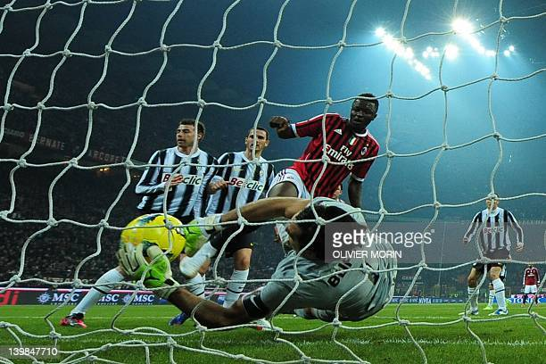 Juventus goalkeeper Gianluigi Buffon grabs the ball in front of AC Milan midfielder Sulley Ali Muntari of Ghana on February 25 2012 during a Serie A...