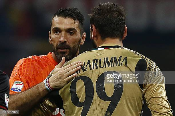 Juventus' goalkeeper Gianluigi Buffon hugs AC Milan's goalkeeper Gianluigi Donnarumma after the Italian Serie A football match AC Milan versus...