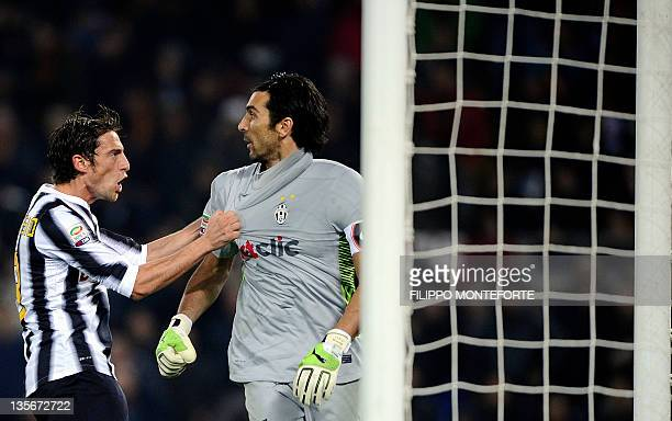 Juventus goalkeeper Gianluigi Buffon is congratulated by midfielder Claudio Marchiso after saving a penalty kick against AS Roma Francesco Totti...