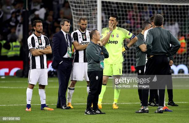 Juventus goalkeeper Gianluigi Buffon Juventus' Claudio Marchisio and Juventus' Giorgio Chiellini appear dejected after the UEFA Champions League...