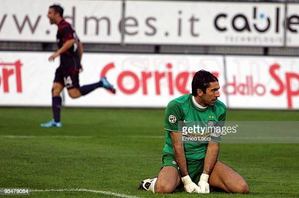 Juventus goalkeeper Gianluigi Buffon looks back at the goal he conceded to Alessandro Matri of Cagliari while Francesco Pisano of Cagliari celebrates...