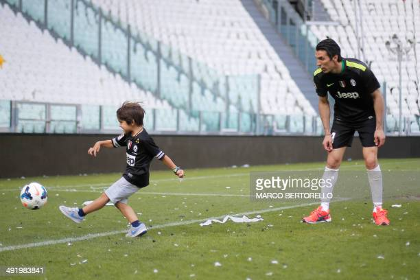 Juventus' goalkeeper Gianluigi Buffon plays with his son after the Italian Serie A football match Juventus vs Cagliari and the trophy ceremony of the...