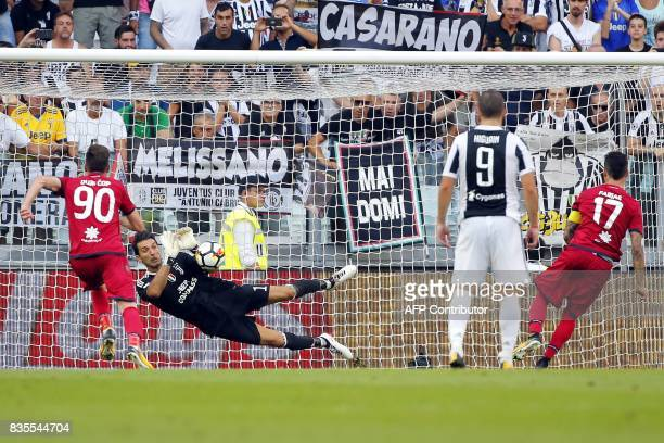 Juventus' goalkeeper Gianluigi Buffon saves a penalty kick during the Italian Serie A football match Juventus vs Cagliari on August 19 2017 at the...