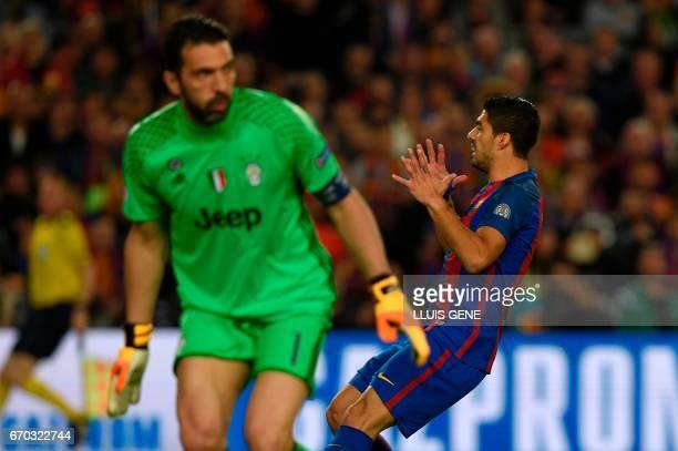 Juventus' goalkeeper Gianluigi Buffon stands infront of Barcelona's Uruguayan forward Luis Suarez during the UEFA Champions League quarterfinal...