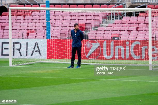 Juventus' goalkeeper Gianluigi Buffon stands on the field at the Camp Nou stadium in Barcelona on April 18 2017 on the eve of the UEFA Champions...
