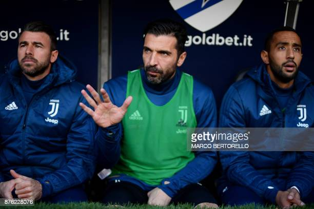 Juventus' goalkeeper Gianluigi Buffon waves from the bench before the Italian Serie A football match Sampdoria Vs Juventus on November 19 2017 at the...