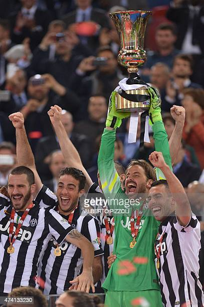 Juventus' goalkeeper Marco Storari holds the trophy with teammates after winning 21 the Italian Tim Cup final match between Juventus and Lazio on May...