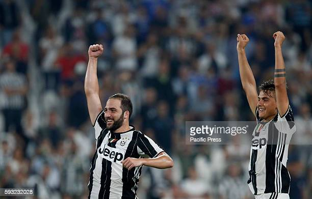 Juventus Gonzalo Higuain left and Paulo Dybala greets fans at the end of the Italian Serie A football match between Juventus and Fiorentina at the...