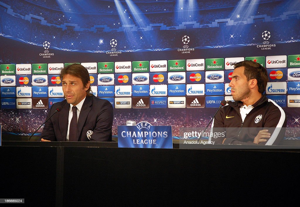 Juventus' head coach Antonio Conte (L) and Carlos Tevez (R) hold a press conference at Juventus Stadium on November 4, 2013 in Turin, Italy. Juventus will face Real Madrid in a UEFA Champions League Group B soccer match at Juventus Stadium on November 5.