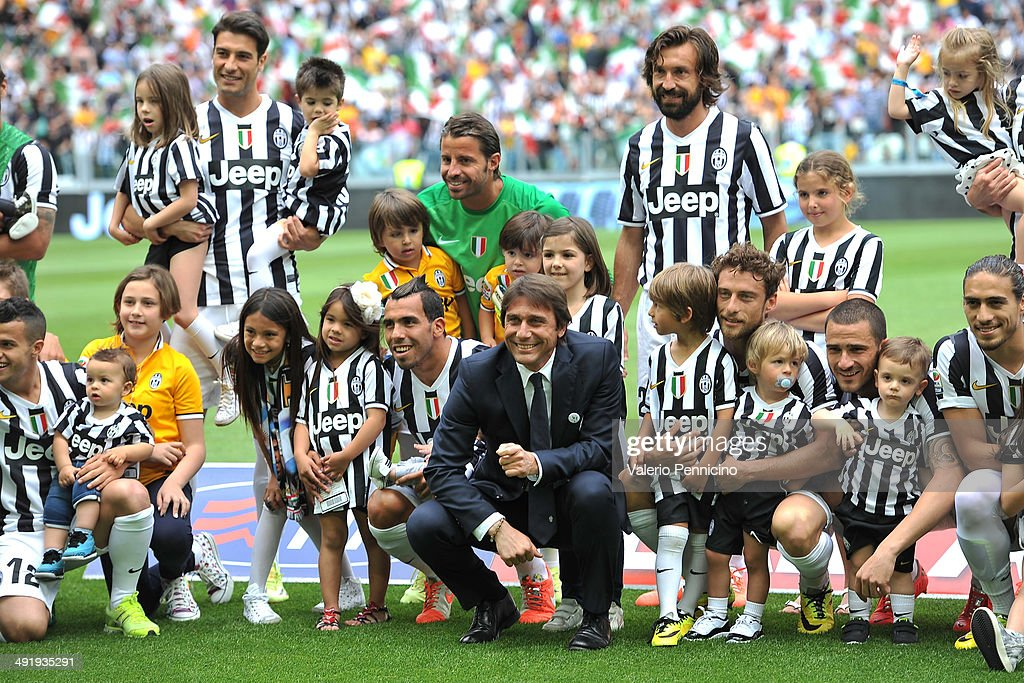 Juventus head coach <a gi-track='captionPersonalityLinkClicked' href=/galleries/search?phrase=Antonio+Conte&family=editorial&specificpeople=2379002 ng-click='$event.stopPropagation()'>Antonio Conte</a> (C) and players with their children during the Serie A match between Juventus and Cagliari Calcio at Juventus Arena on May 18, 2014 in Turin, Italy.