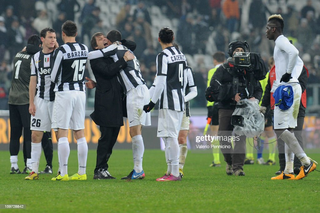 Juventus head coach Antonio Conte (C) celebrates victory at the end of the Serie A match between Juventus and Udinese Calcio at Juventus Arena on January 19, 2013 in Turin, Italy.