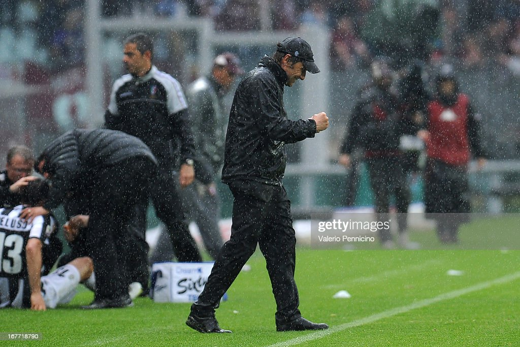 Juventus head coach Antonio Conte celebrates victory at the end of the Serie A match between Torino FC and Juventus at Stadio Olimpico di Torino on April 28, 2013 in Turin, Italy.