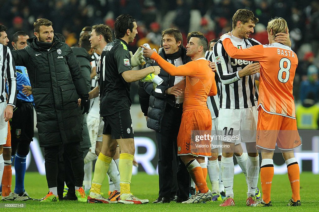 Juventus head coach Antonio Conte (C) greets Antonio Di Natale (R) of Udinese Calcio at the end of the Serie A match between Juventus and Udinese Calcio at Juventus Arena on December 1, 2013 in Turin, Italy.