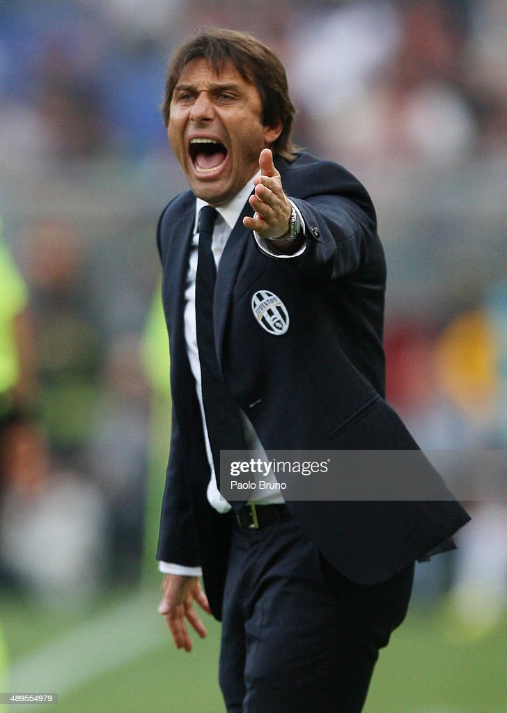 Juventus head coach <a gi-track='captionPersonalityLinkClicked' href=/galleries/search?phrase=Antonio+Conte&family=editorial&specificpeople=2379002 ng-click='$event.stopPropagation()'>Antonio Conte</a> reacts during the Serie A match between AS Roma and Juventus at Stadio Olimpico on May 11, 2014 in Rome, Italy.